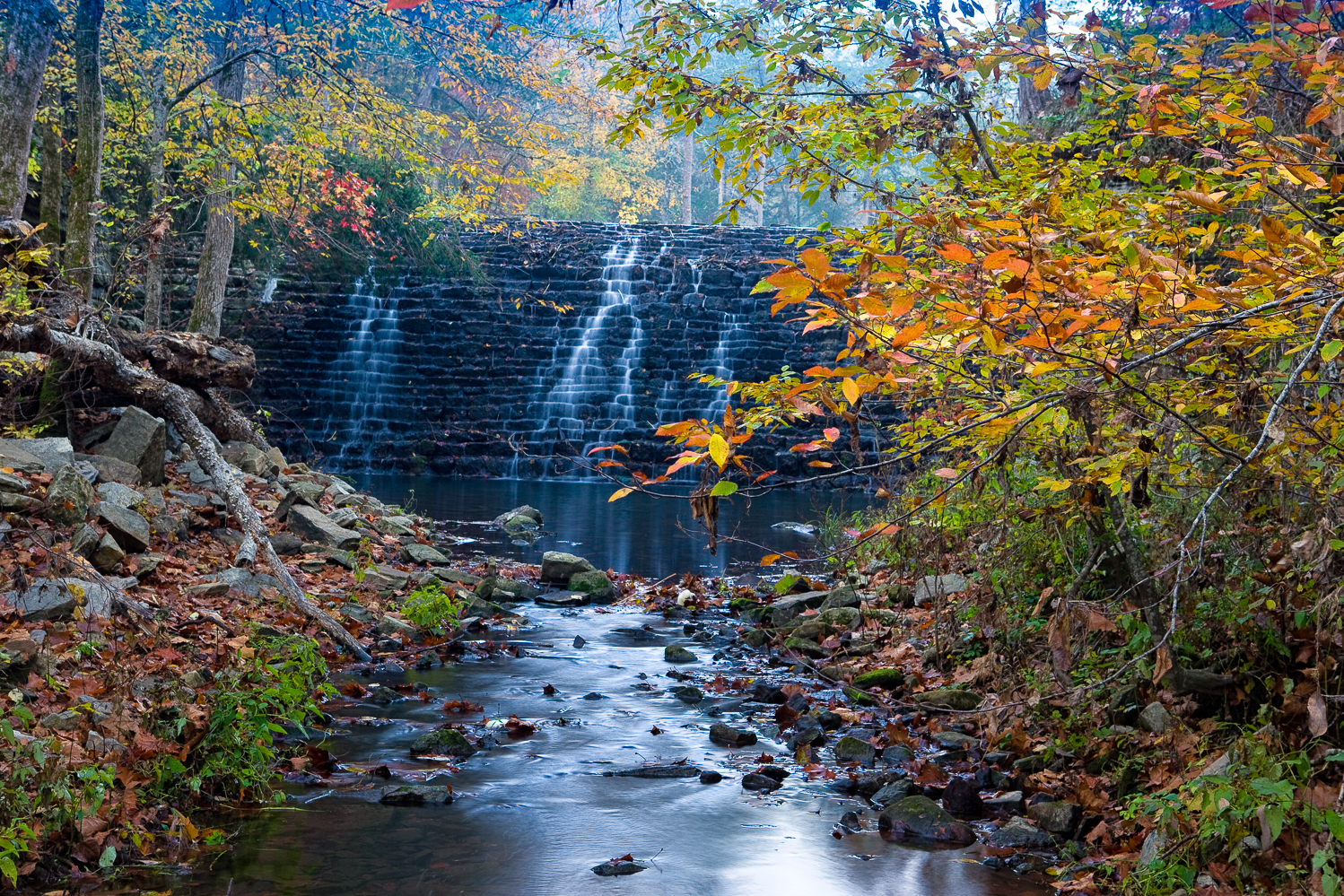 Fall view of Gunner Pool CCC dam at Gunner Pool Campground
